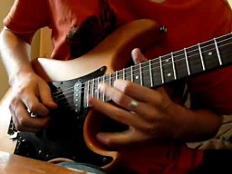 Gumisie na gitarze